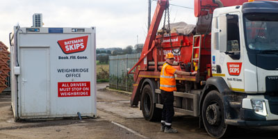 Skip lorry at weighbridge